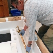 Hal Jones, owner of Atelier Art Services & Storage, carefully packs Brig. Gen. Isaac Wistar's sword for transport