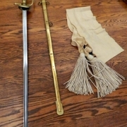 (Left to right) Wistar's 1840 Foot Infantry Officer's sword and scabbard, and buff-colored sword sash.