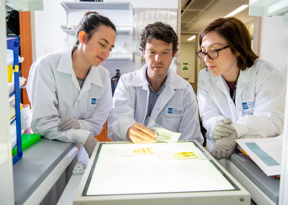 Alessandro and students in lab